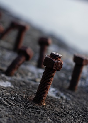 rusty nuts on concrete